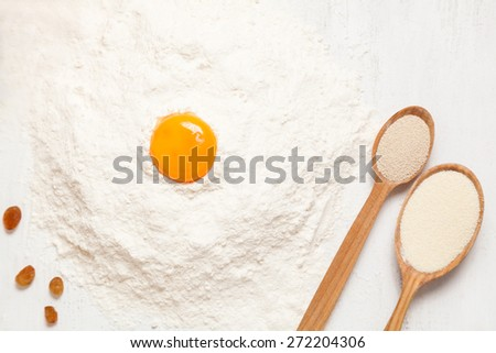 Pastry ingredients. Egg, flour and yeast on white rustic table background - stock photo