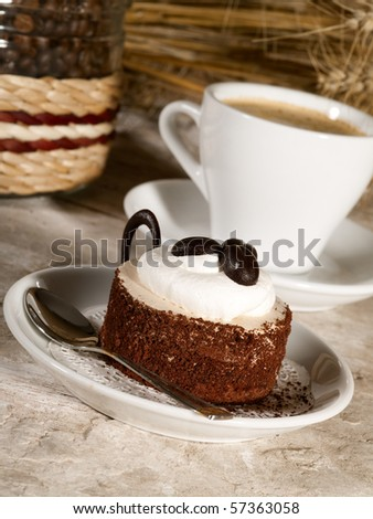 pastry on the plate with cup of espresso - stock photo