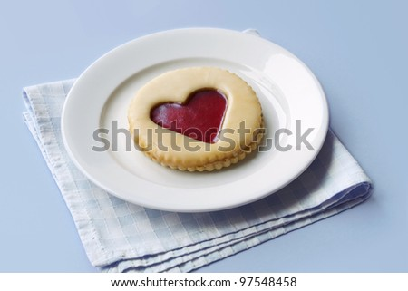 Pastry with jam heart on a plate