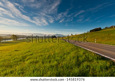 Pasture along the Irrigation Canal and Dam in Switzerland - stock photo