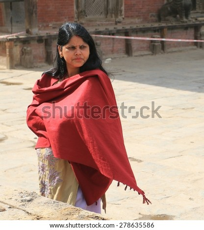 PATAN - APRIL 25: Nepalese women looks around after earthquake, near Durbar square, end of April 2015, Patan, Nepal - stock photo