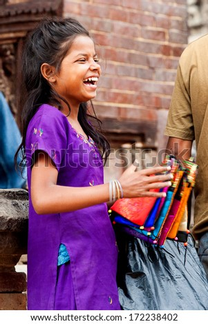 PATAN, NEPAL - OCT 15: Unidentified girl on Oct 15, 2007 in Patan, Nepal.  Patan is listed as a World Heritage by UNESCO for its rich culture, temples, and wood artwork.
