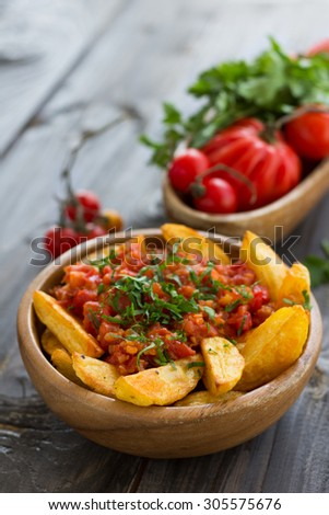 , traditional Spanish tapas, baked potatoes with spicy tomato sauce ...