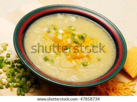 Patatoe Soup with cheese and chives - stock photo