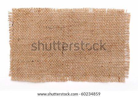 patch of aged sack material over white background - stock photo