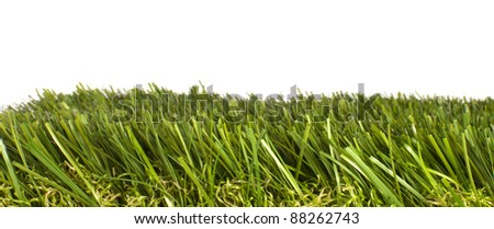 patch of manicured green artificial grass on a white background - stock photo