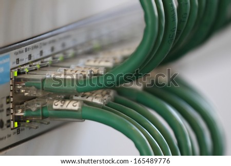 patch panel cables for connecting to broadband internet in a industrial rack - stock photo