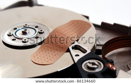 patch to repair a broken hard drive - stock photo