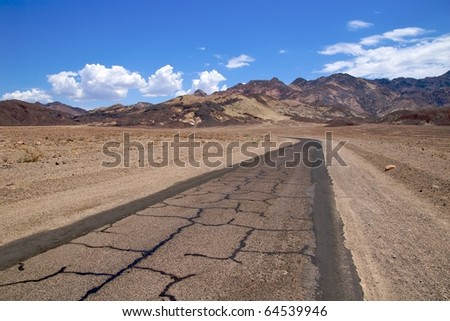 Patchy asphalt road, Artists Drive, Death Valley National Park - stock photo