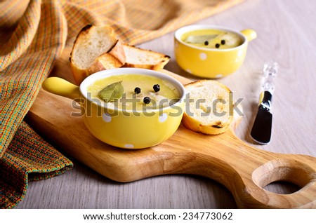 Pate covered with fat portions ceramic form yellow - stock photo