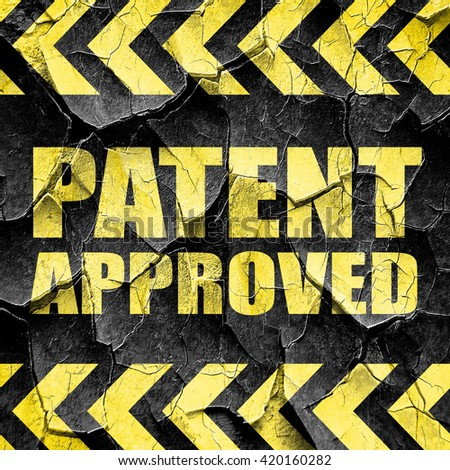 patent approved, black and yellow rough hazard stripes - stock photo
