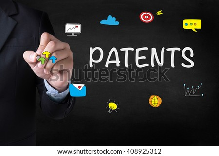 PATENTS Businessman drawing Landing Page on blurred abstract background - stock photo
