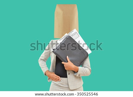 Paternity Child Support Forms in leather binder held by woman with brown paper bag on her head isolated on green background - stock photo