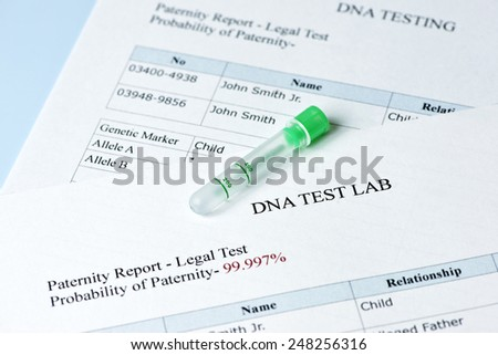 Paternity test results report with lab sample test tube. - stock photo