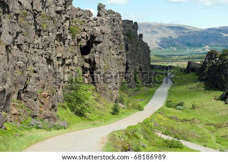 path along Canyon Almannagja between the Eurasian and North American tectonic plates, Iceland - stock photo
