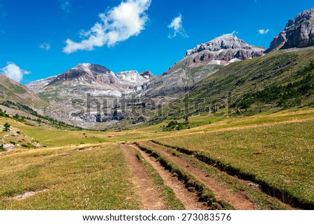 Path along high mountains in the Spanish Pyrenees - stock photo