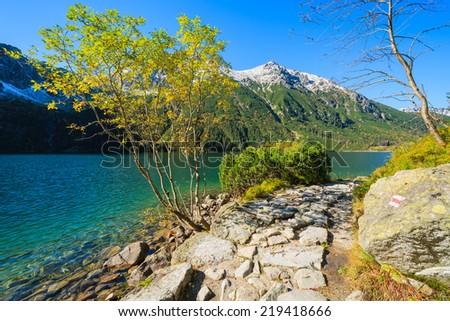 Path along Morskie Oko alpine lake in autumn colours, High Tatra Mountains, Poland - stock photo