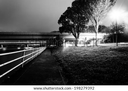 Path and bridges along the Potomac River at night, in Washington, DC. - stock photo