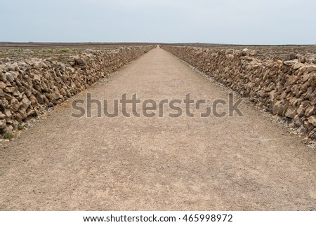 Path between stone walls