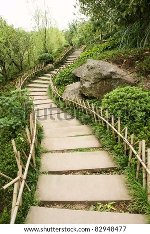 Path in park with bamboo fence - stock photo