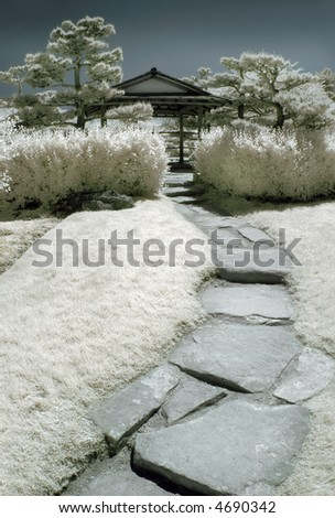 Path into a Japanese garden in infrared. - stock photo