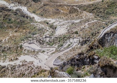 Path leading from the rim to the lake in Quilotoa crater, Ecuador - stock photo