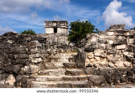 Path leading towards Mayan buildings at Tulum, Quintana Roo, Mexico. - stock photo