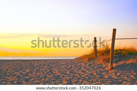 Path on the sand going to the ocean in Miami Beach Florida at sunrise or sunset, beautiful nature landscape, retro instagram filter for vintage looks - stock photo