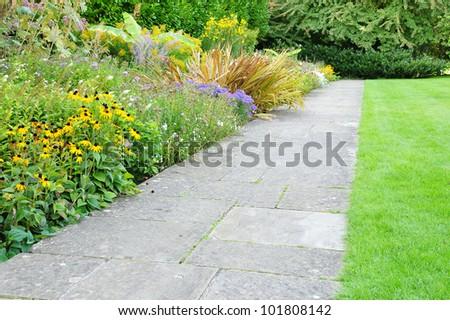Path through a Tranquil Garden - stock photo