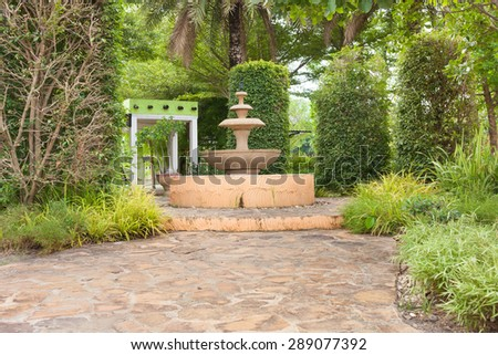 Path through in the tropical garden landscape . - stock photo