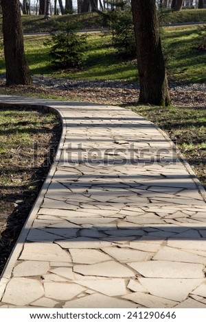Path through the landscaped park - stock photo