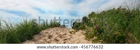 Path to beach over a dune with sky and clouds, Wellfleet Massachusetts on Cape Cod-Proportionate to Large Mobile Banner  - stock photo