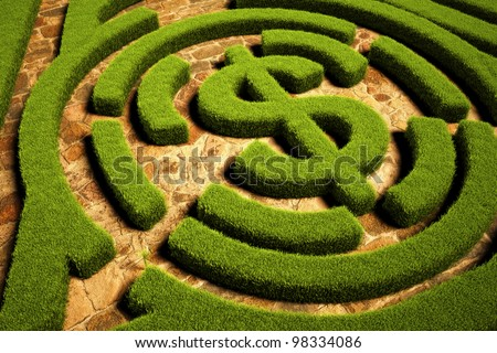 Path to Financial Freedom, Hedgerow maze leading to a dollar symbol - stock photo