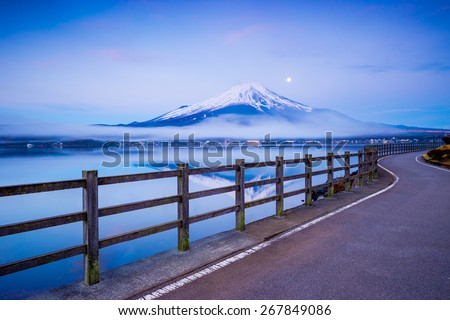 Path to Mt.Fuji at moonrise, Yamanaka lake, Yamanashi, Japan - stock photo