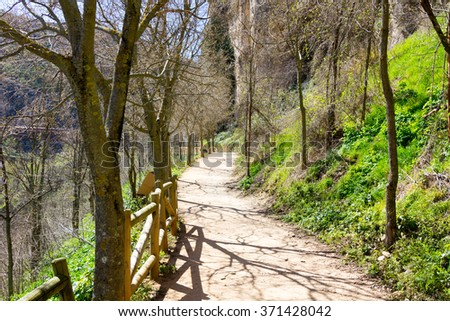 Path with wooden railing in the countryside, in the city of Cuenca, Spain - stock photo