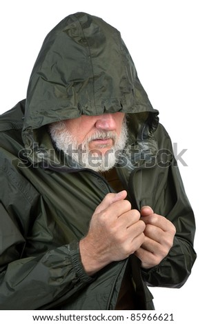 pathetic senior man in green waterproof jacket - stock photo