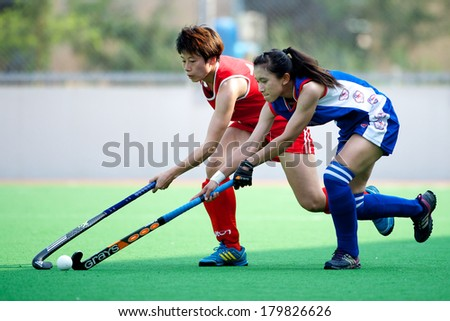 PATHUM THANI THAILAND-FEB 18:Su Pei Ling (blue)of Taipei  for the ball during Women's Asian Games Qualifiers 2014 Taipei  and Hong Kong at QueenSirikit Stadium on February 18,2014 in Thailand