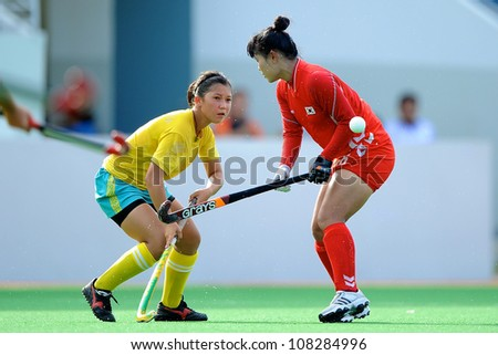 PATHUM THANI,THAILAND-JULY 3:Urmanova Guzal (Y) of Kazakhstan fights for the ball during the Women�s Junior AsiaCup Korea and Kazakhstan at QueenSirikit Stadium on July3,2012 in PathumThani,Thailand.