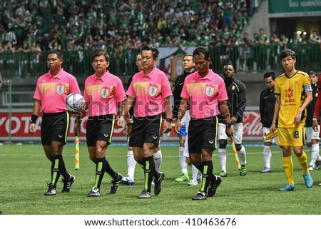 PATHUM THANI,THAILAND-MAR 6:Unidentified referee of Thailand in action during Thai Premier League 2016 between Bangkok Glass FC.and Osotspa M-150 at Leo Stadium on March 6,2016 in PathumThani,Thailand - stock photo