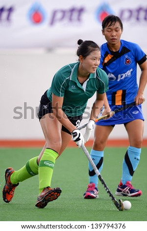 PATHUM THANI THAILAND-MAY 24:Han Taejeong (L) of Kasetsart HC. in action during The PTT Thailand Hockey League between Kasetsart HC.and PTT Power at QueenSirikit Stadium on May 24,2013 in Thailand