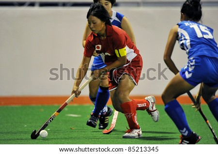 PATHUM THANI THAILAND-SEP20:Mano Yukari(R) during in ptt grils asia cup 2011(U18),Jap(R) Vs Kor(B) at Commemoration Of Queen Sirikit Sports Stadium on Sep20,2011 in Pathum Thani Thai