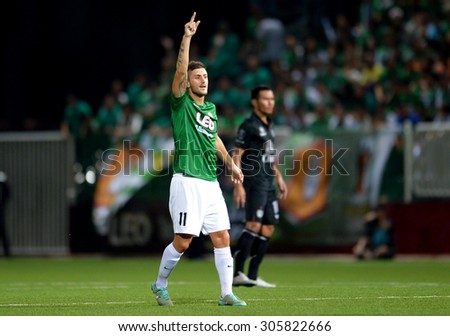 PATHUMTHANI, THAILAND- AUG12: Daniel Garcia Rodriguez of BGFC in action during Thai Premier League 2015 between BGFC and BuriramUtd at Leo Stadium on August 12, 2015 in Thailand. - stock photo