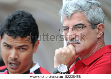 PATHUMTHANI,THAILAND-AUG,2: Henrique Calisto Head Coach of MTUTD during in Toyota League Cup match 2 Round of 16 teams between KU and MTUTD at Thupatemee Stadium :Aug 2,2011.Pathumthani,Th.