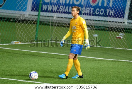 PATHUMTHANI, THAILAND- AUG12: Narit Taweekul goalkeeper of BGFC in action during Thai Premier League 2015 between BGFC and BuriramUtd at Leo Stadium on August 12, 2015 in Thailand. - stock photo