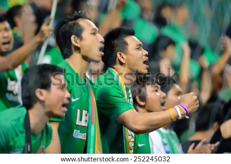 PATHUMTHANI,THAILAND-FEB2015:Unidentified BangkokGlassFC supporters during AFC Champions League 2015 : BangkokGlassFC(Th) 3-0 JohorDarulTakzim(My) at LeoStadium on February 10, 2015 in Thailand - stock photo