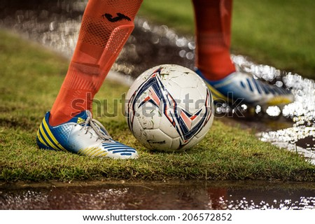 PATHUMTHANI THAILAND-Jul19:Football being kicked on lawn during the Thai Premier League between Police United and Sisaket FC at Thammasat Stadium on July19,2014,Thailand  - stock photo