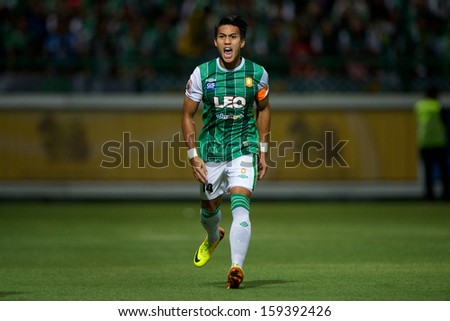 PATHUMTHANI,THAILAND-20 JULY:Teeratep Winothai #14 of Bangkok Glass fc. in action during Thai Premier League between Bangkok Glass fc.and Burirum Utd.at Leo Stadium on July 20,2013 in Thailand - stock photo