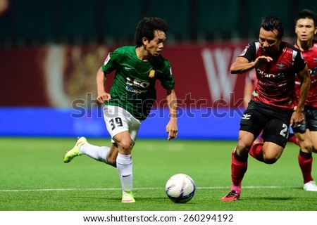 PATHUMTHANI,THAILAND, MARCH 2015 :Tanasith Siripala(G) of BGFC in action during geam Thai premier League 2015 between Bangkok Glass FC and Bangkok UTD at LeoStadium on MARCH 11, 2015 in Thailand - stock photo