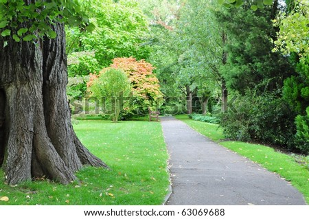 Pathway in a Beautiful Green Park - stock photo
