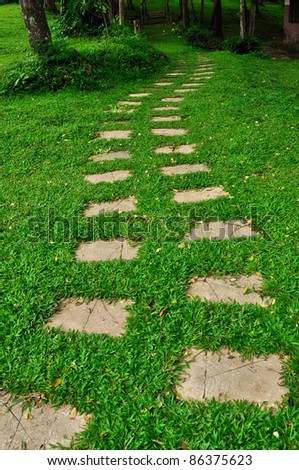 Pathway in a green park - stock photo